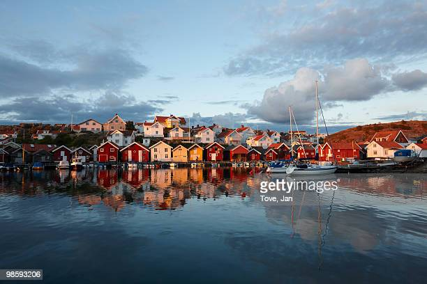 houses by the sea at sunset, sweden. - fishing village stock pictures, royalty-free photos & images