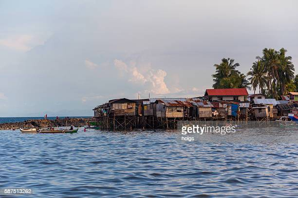 houses by the sea in davao, philippines - davao city stock photos and pictures