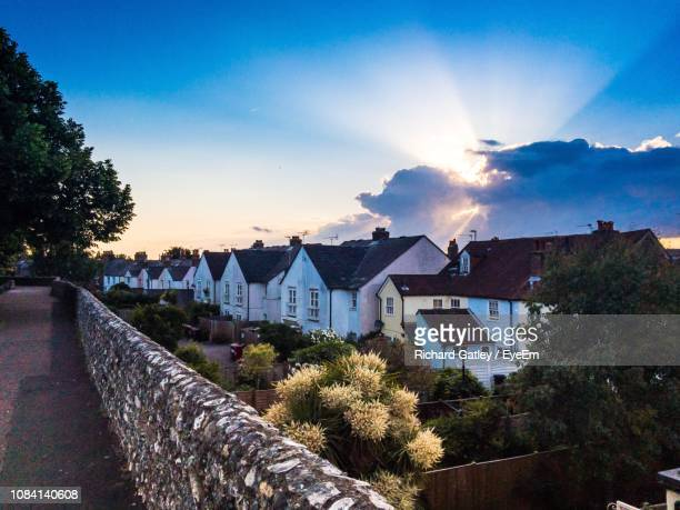 houses by trees against sky - chichester stock pictures, royalty-free photos & images