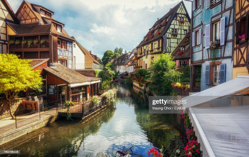 Houses By Water Against Sky : Stock Photo