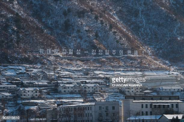 Houses covered in snow are seen in North Korea's Sakchu county in North Pyongan province as seen from the Chinese border city of Dandong on January...