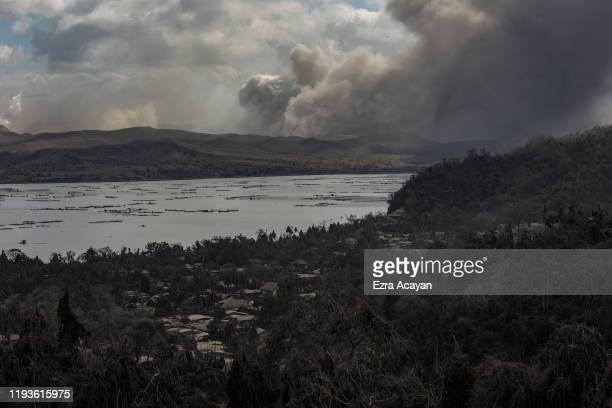 Houses covered in volcanic ash are seen as Taal Volcano erupts on January 14 2020 in Laurel Batangas province Philippines The Philippine Institute of...