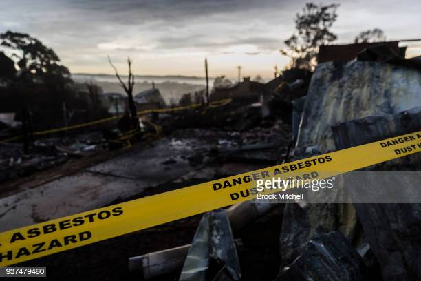 Houses destroyed by bushfire are seen at dawn on March 25 2018 in Tathra Australia A bushfire which started on 18 March destroyed 65 houses 35...
