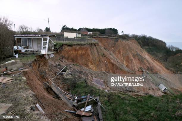 Houses destructed or threatened of destruction by the collapse of the cliff are pictured on January 30, 2105 in Dieppe, northwestern France. - Willy...