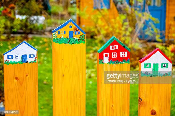 Houses Drawn On Wooden Fence