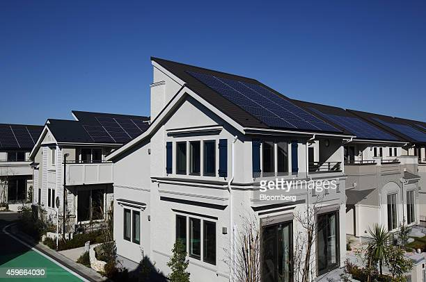Houses equipped with solar panels built by Mitsui Fudosan Co. Stand at the Fujisawa Sustainable Smart Town, developed by a consortium led by...