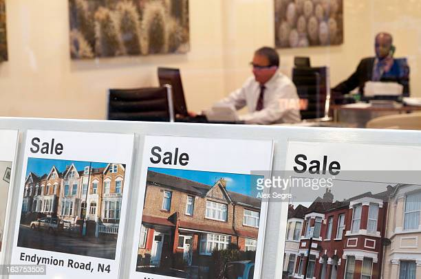 CONTENT] Houses for sale in estate agents window display London England UK