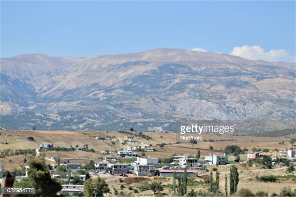 Houses from a small village lying down near a mountain is pictured on the first day of Eid alAdha in southern Kahramanmaras province of Turkey on...