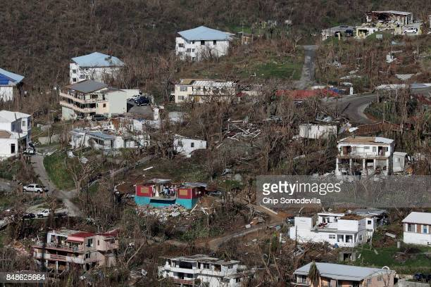 Houses in a variety of conditions some with and without roofs dot the hillsides more than a week after Hurricane Irma made landfall September 17 2017...