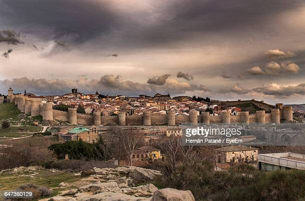 Houses In Avila Against Cloudy Sky