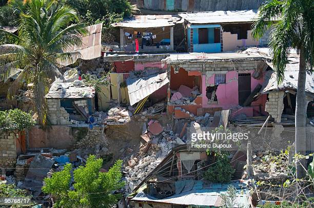 Houses in Canape Vert are badly damaged following a major quake January 14 2010 in PortauPrince Haiti Planeloads of rescuers and relief supplies...
