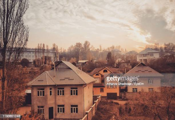 houses in city against sky during sunset - kyrgyzstan stock pictures, royalty-free photos & images