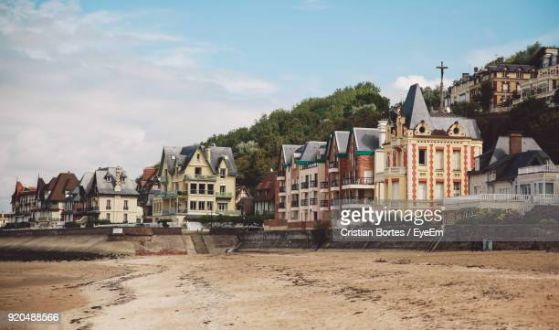 houses in city against sky - trouville sur mer stock pictures, royalty-free photos & images