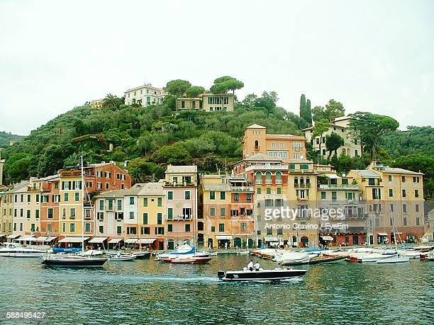 Houses In Front Of River Against Clear Sky At Portofino