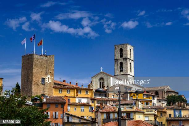 Houses in Grasse with the tower of Notre-Dame du Puy Cathedral in the background, Grasse, Provence-Alpes-Côte d'Azur, France
