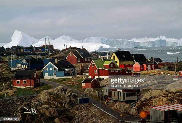 Houses in Ilulissat village with the Ilulissat Icefjord in the background Greenland