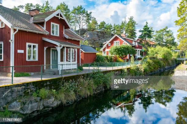 houses in lennartsfors next to the dalsland canal at lennartsfosrs in sweden on a summer day. - dalsland stock photos and pictures