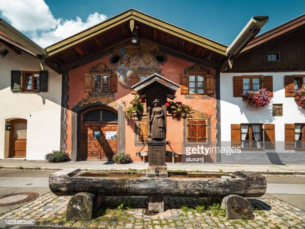 houses in mittenwald village in the bavarian alps germany - mittenwald stock pictures, royalty-free photos & images