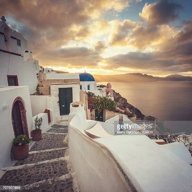 Houses In Oia At Santorini Against Sky During Sunset