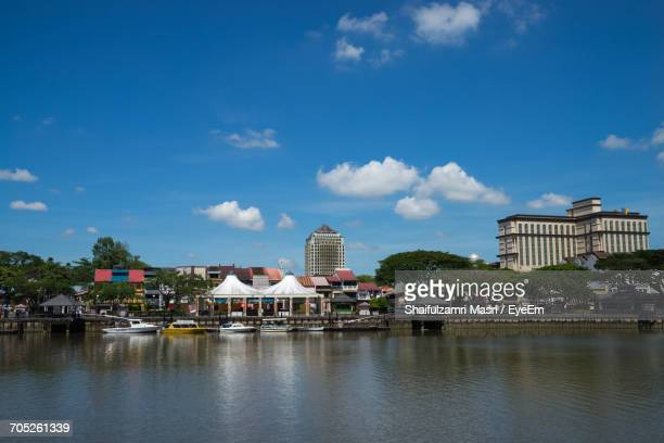 houses in river against cloudy sky - shaifulzamri eyeem stock pictures, royalty-free photos & images