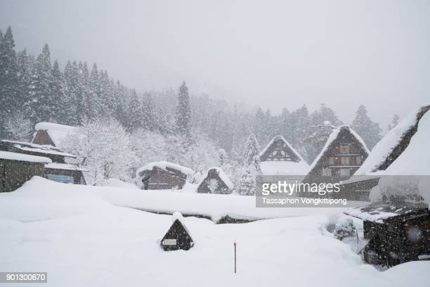 houses in Shirakawago heritage village snow falling in Gifu, Japan