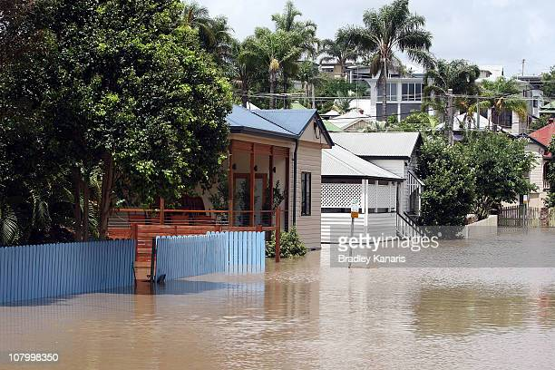 Houses in the Brisbane suburb of Milton are flooded on January 12 2011 in Brisbane Australia Twelve people so far have been confirmed dead in towns...