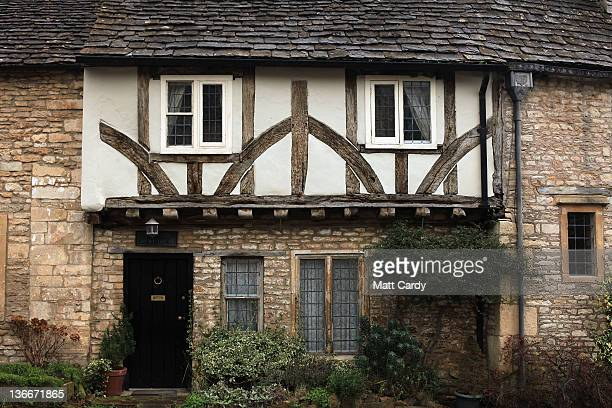 Houses in the centre of the village of Castle Combe that was recently featured in Steven Spielberg's latest film the wartime drama War Horse are seen...