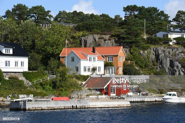 Houses in the on waterside of Sogne harbour in southern norway in Norway in August 22nd 2017