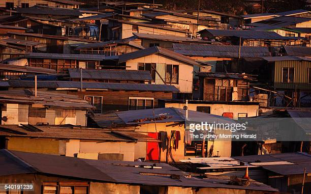 Houses in the suburbs of Port Moresby Papua New Guinea on the 19 July 2002 from the Tatana Village SMH NEWS Picture by JACKY GHOSSEIN