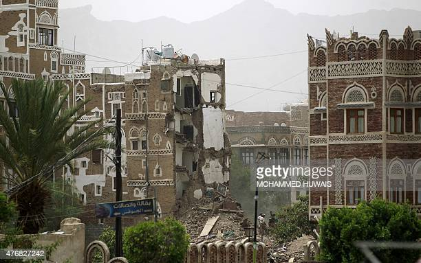 Houses in the UNESCOlisted heritage site in the old city of Yemeni capital Sanaa are seeing destroyed on June 12 2015 following an overnight Saudiled...