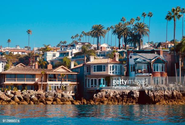 houses in town against blue sky - newport beach stock pictures, royalty-free photos & images