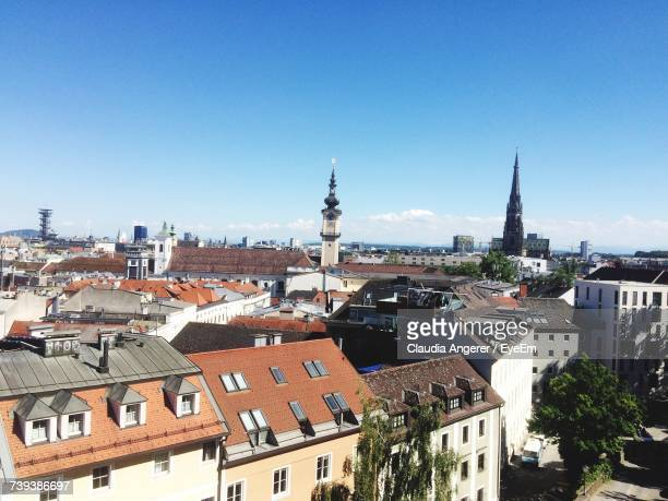 houses in town against clear blue sky - linz stock pictures, royalty-free photos & images