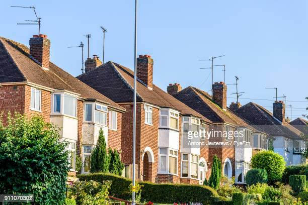 houses in town against clear sky - northampton england ストックフォトと画像
