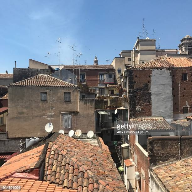 houses in town against clear sky - catania stock pictures, royalty-free photos & images