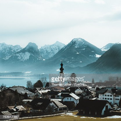 Houses In Town Against Mountains During Winter