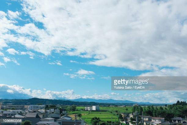 houses in town against sky - iwate prefecture stock photos and pictures