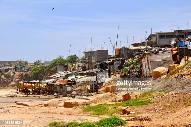 houses in town against sky - slum stock pictures, royalty-free photos & images
