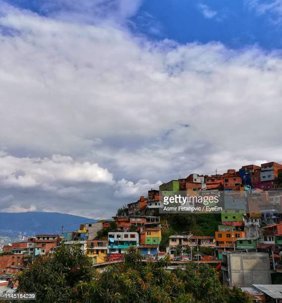 houses in town against sky - medellin colombia stock pictures, royalty-free photos & images