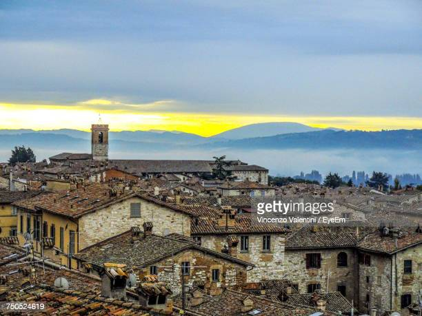 houses in town against sky - gubbio stock pictures, royalty-free photos & images