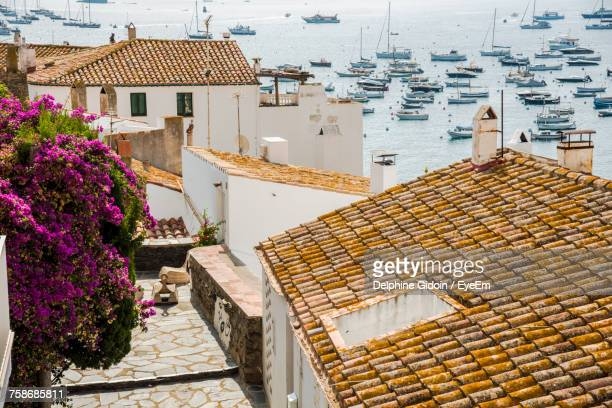 houses in town against sky - cadaques stock pictures, royalty-free photos & images