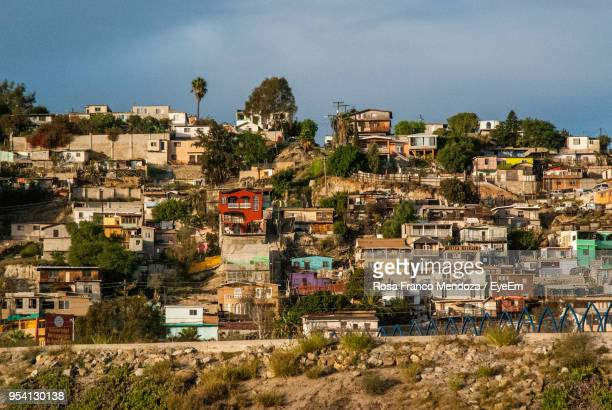 houses in town against sky - tijuana stock pictures, royalty-free photos & images