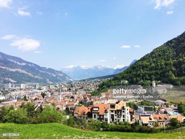 houses in town against sky - principality of liechtenstein stock pictures, royalty-free photos & images