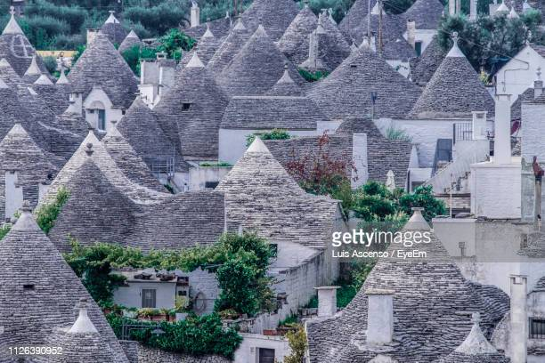 houses in town - alberobello stock pictures, royalty-free photos & images
