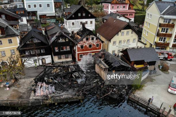 Houses lay burnt out after a fire in Hallstatt, Austria on November 30, 2019. - Starting from a hut at the lake, several huts or houses were on fire...