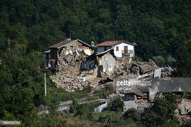 Houses lie destroyed following Wednesday's earthquake on August 26 2016 near Amatrice Italy Italy has declared a state of emergency in the regions...