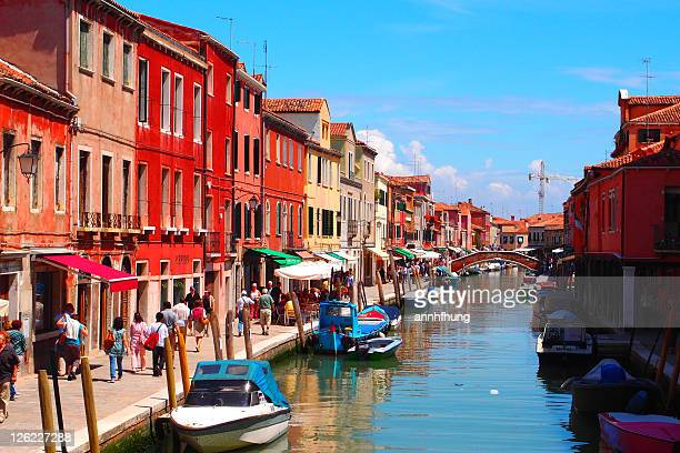houses near harbor with people walking on path way - murano stock pictures, royalty-free photos & images