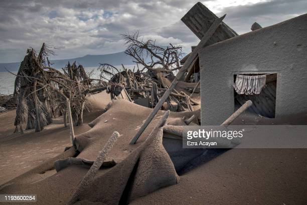 Houses near Taal Volcano's crater are seen buried in volcanic ash from the volcano's eruption on January 14 2020 in Taal Volcano Island Batangas...