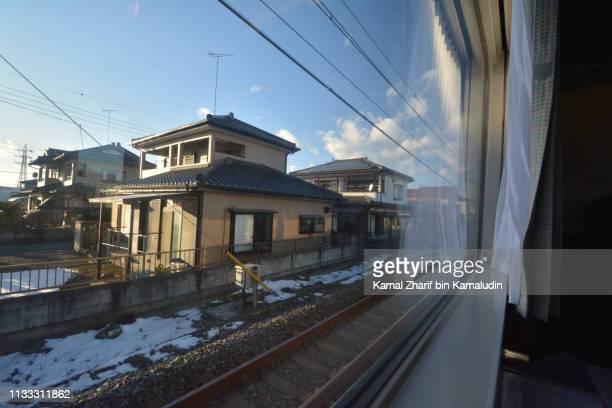 Houses nearby Japanese railway tracks