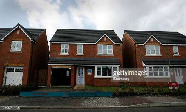 Houses nearing completion are seen at Gin Pit Village a residential housing development by Ben Bailey Homes Ltd in Tyldesley UK on Thursday Feb 23...