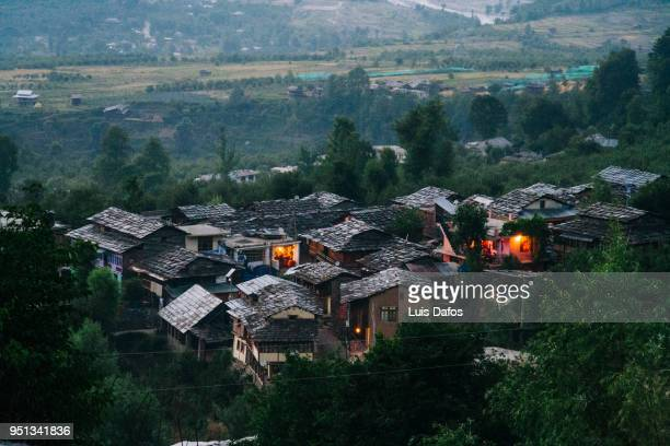 houses of naggar illuminated at dusk - village stock pictures, royalty-free photos & images